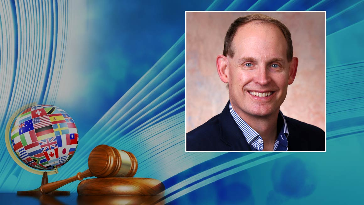 Headshot of Professor Michael Bryant inset into a blue background with gavel andglobe,